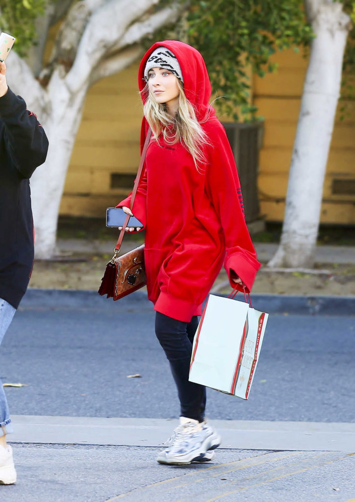 Sabrina Carpenter in a Red Oversized Hoody