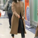 Victoria Beckham in a Beige Coat Arrives at JFK Airport in New York