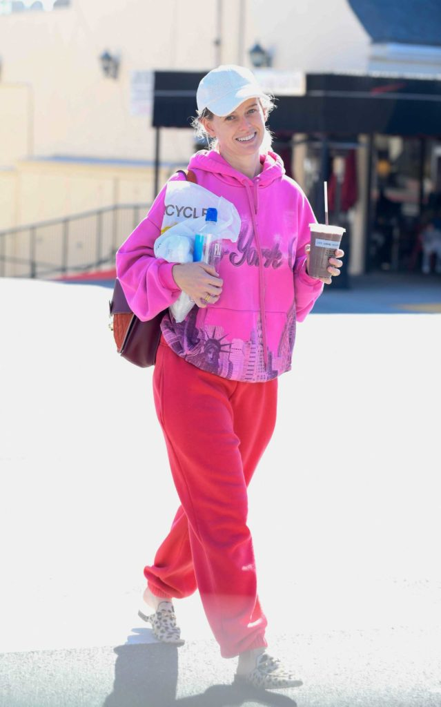 Alice Eve in a Red Sweatpants