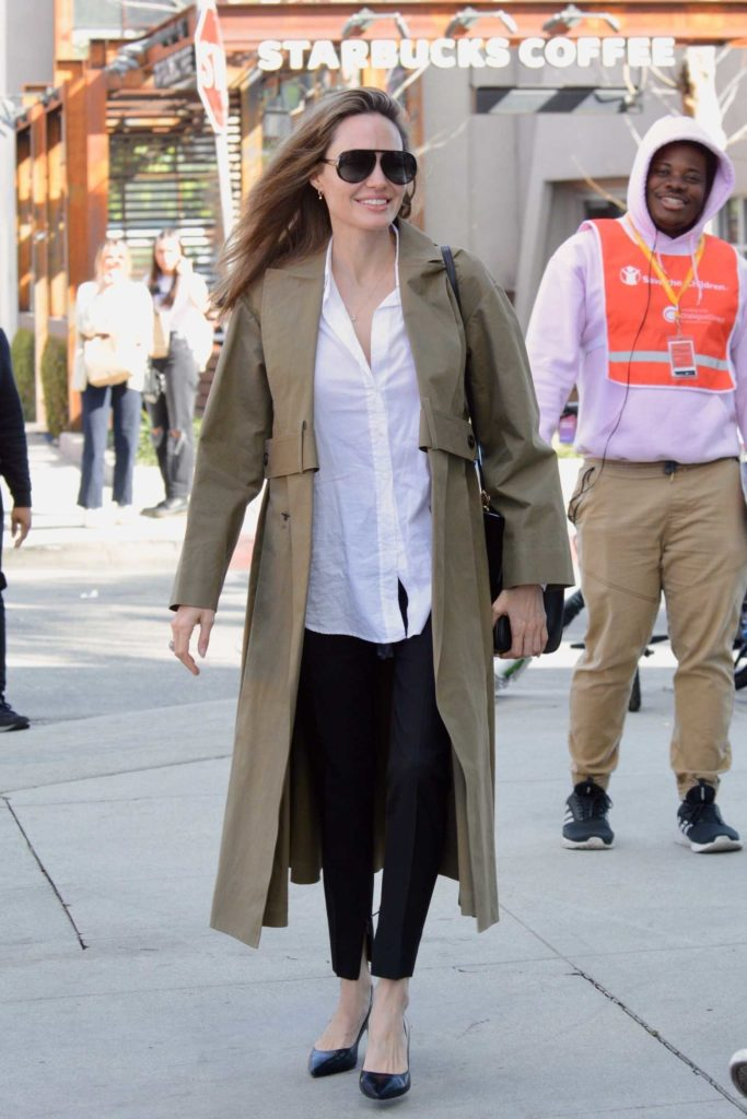 Angelina Jolie in a Beige Trench Coat
