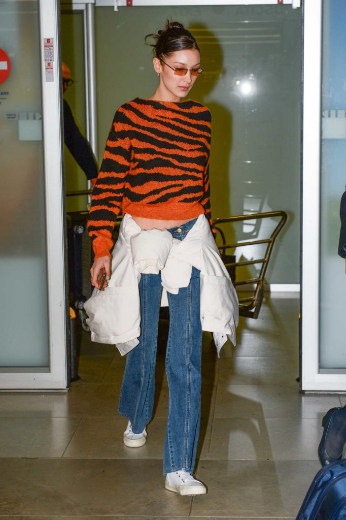 Bella Hadid in a Black and Orange Sweater