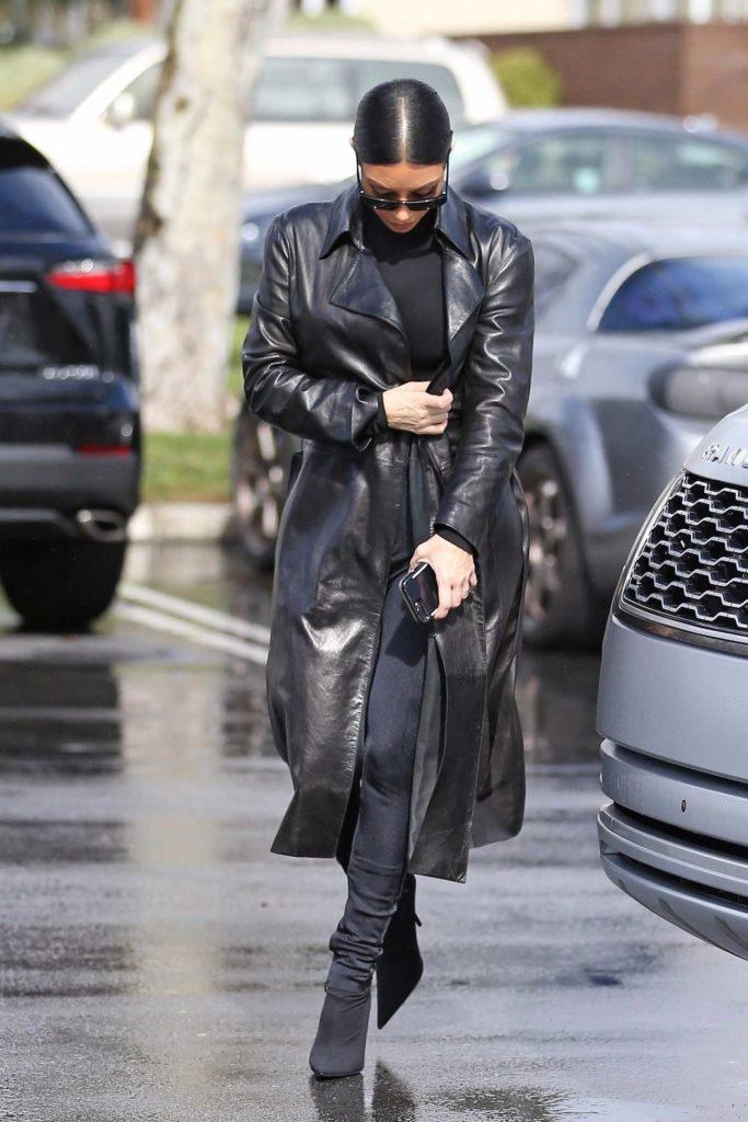 Kim Kardashian in a Black Leather Trench Coat