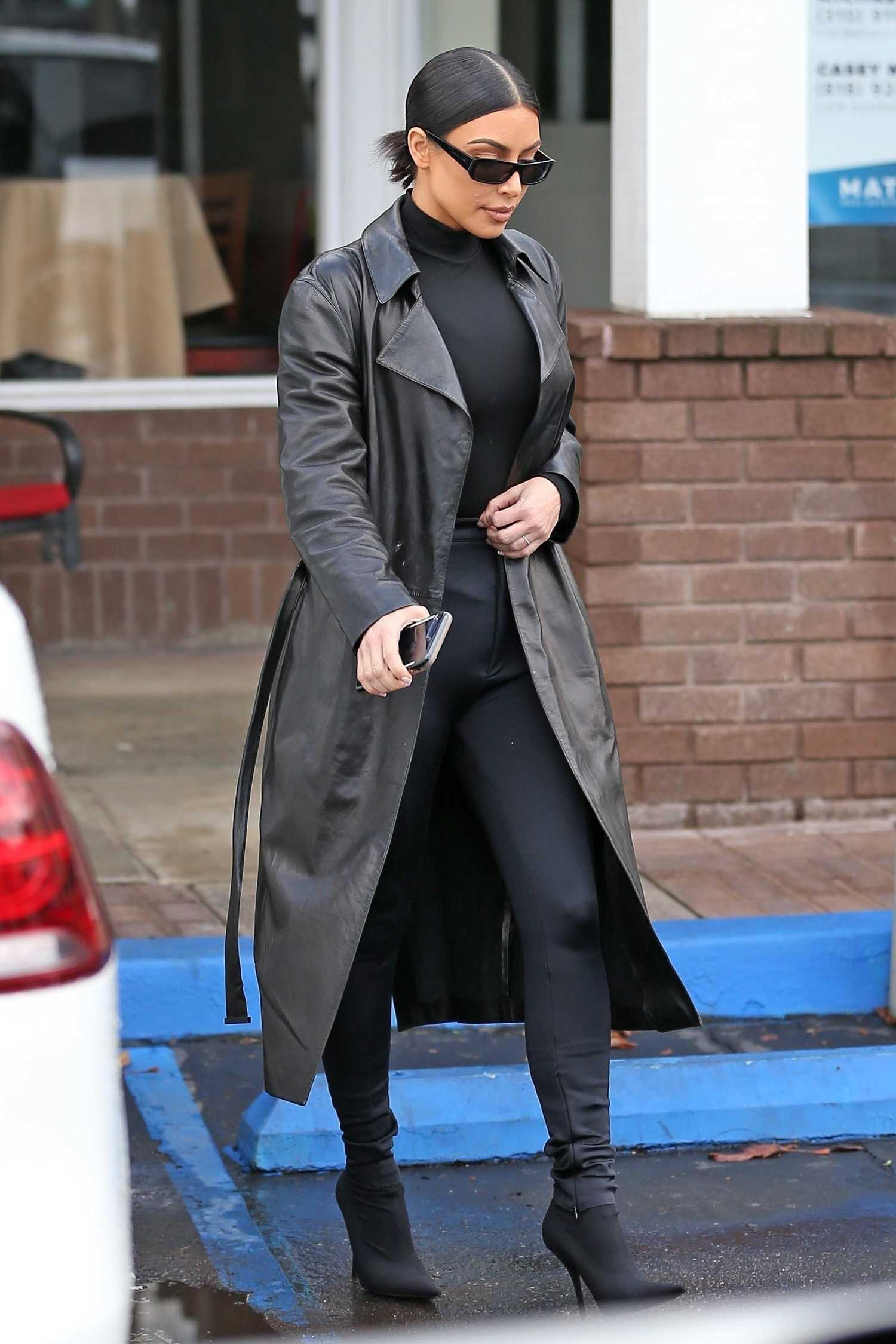 Kim Kardashian In A Black Leather Trench Coat Was Spotted