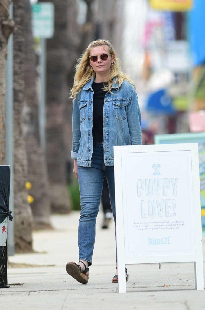 Kirsten Dunst in a Blue Denim Jacket