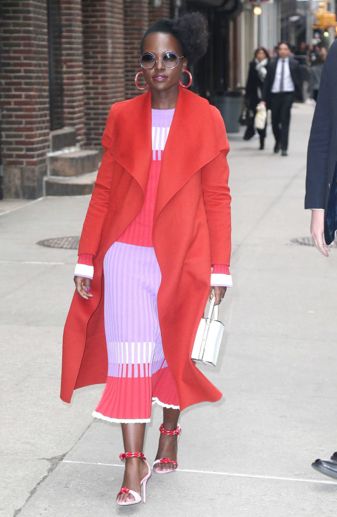 Lupita Nyong'o in a Red Coat