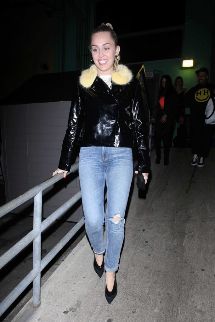 Miley Cyrus in a Blue Ripped Jeans