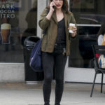 Milla Jovovich in a Black Nike Sneakers Was Seen Out in Los Angeles