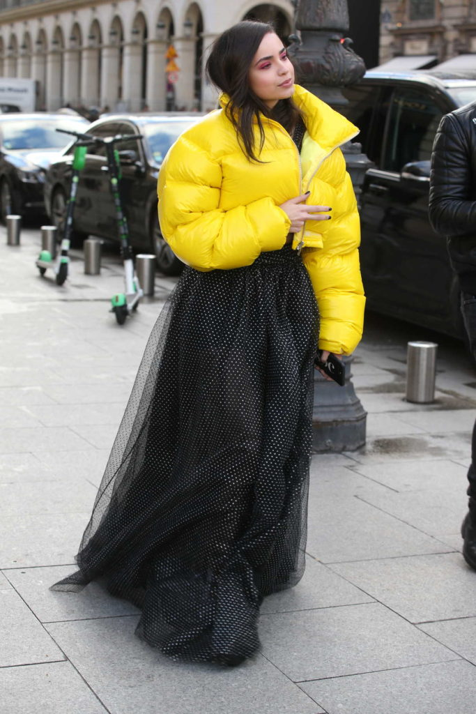 Sofia Carson in a Yellow Puffer Jacket