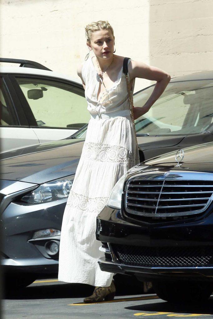 Amber Heard in a Beige Sundress