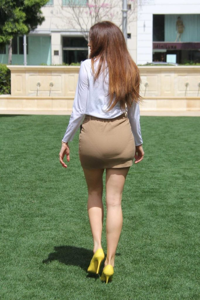 Blanca Blanco in a Short Beige Skirt