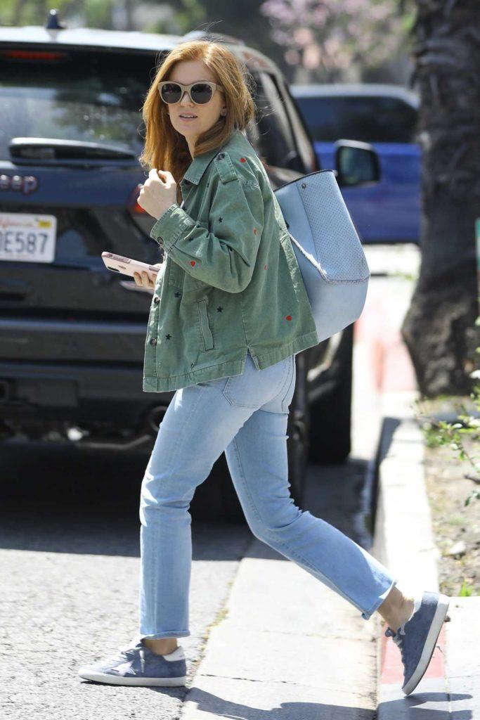 Isla Fisher in a Green Jacket
