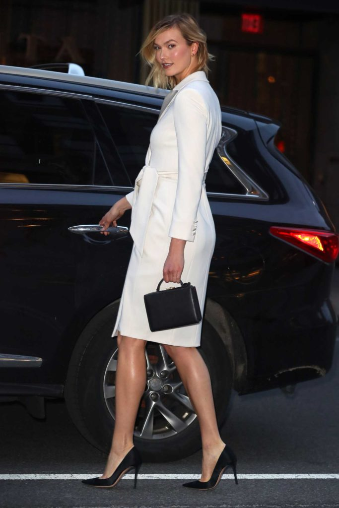 Karlie Kloss in a White Trench Coat