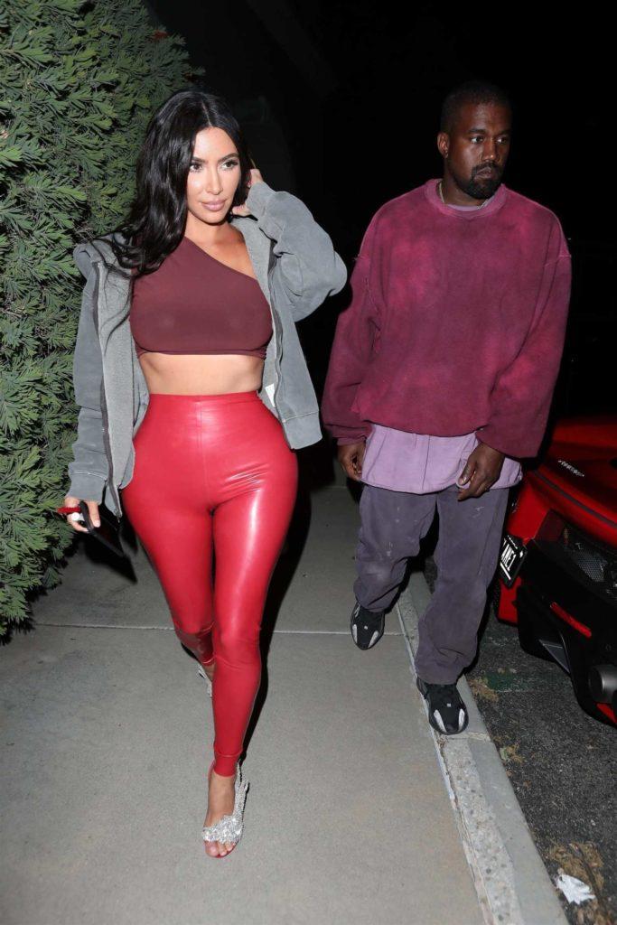 Kim Kardashian in a Red Leggings