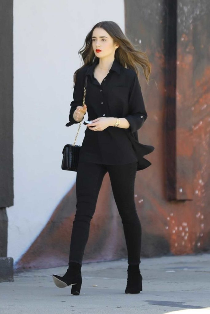 Lily Collins in a Black Blouse