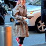 Maisie Williams in a Red Converse All-Star High Tops Returns to Her Hotel in NYC