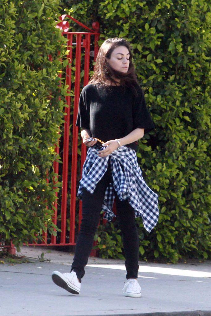 Mila Kunis in a Black T-Shirt