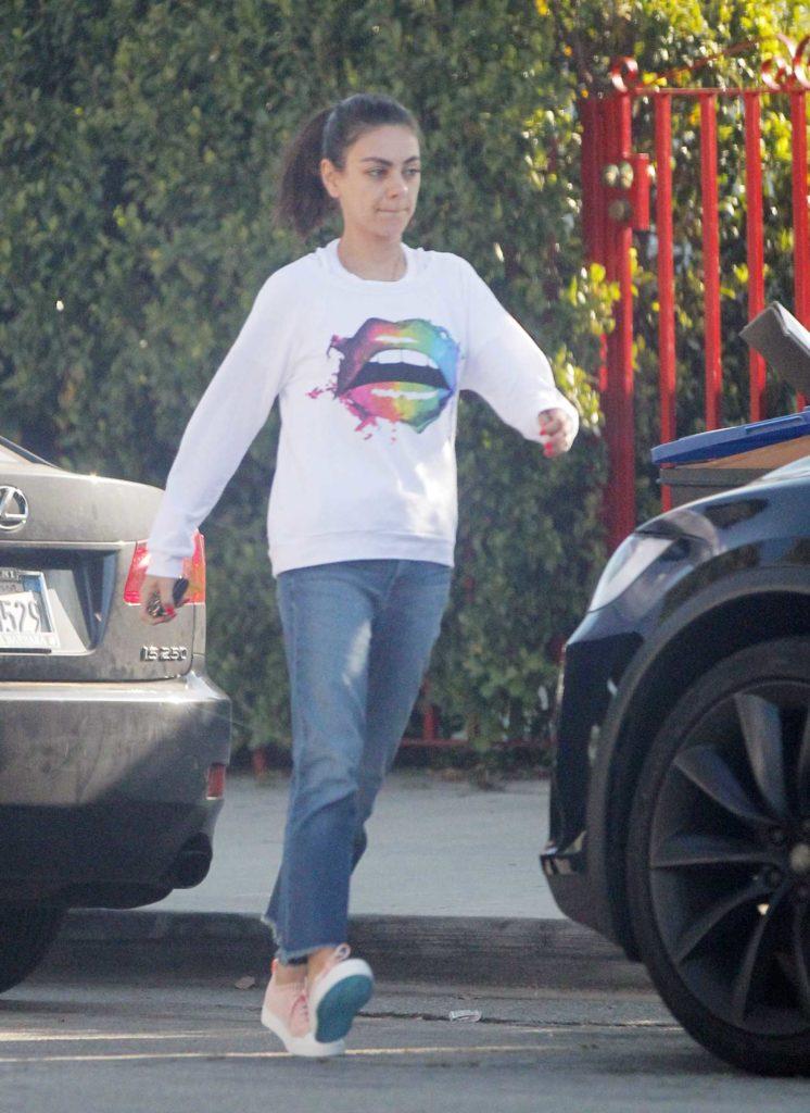 Mila Kunis in a White Sweatshirt