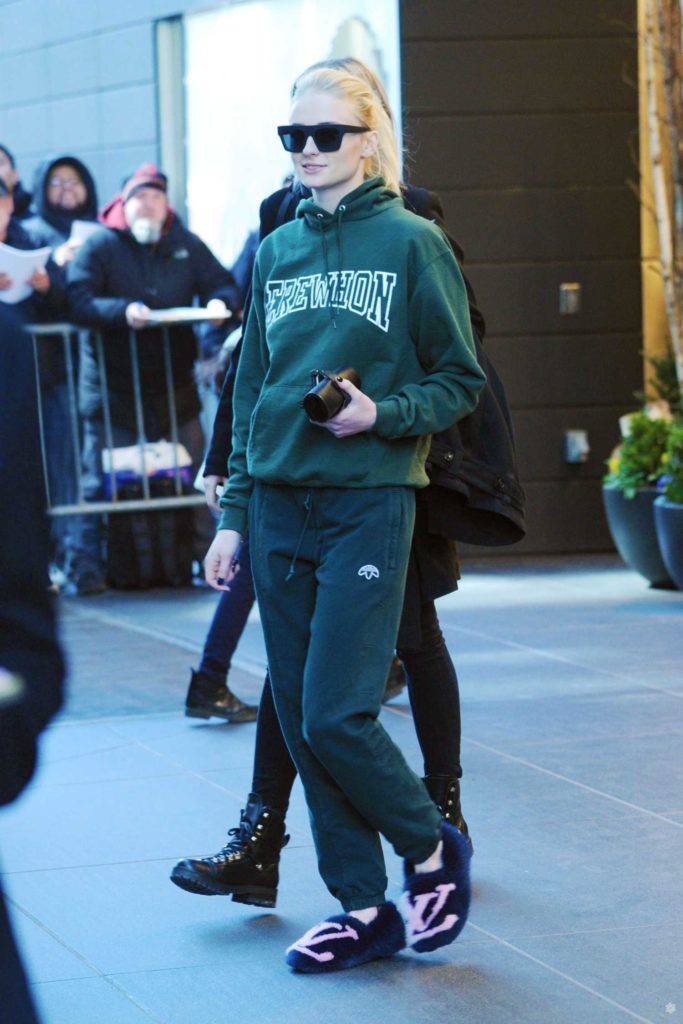 Sophie Turner in a Green Hoody