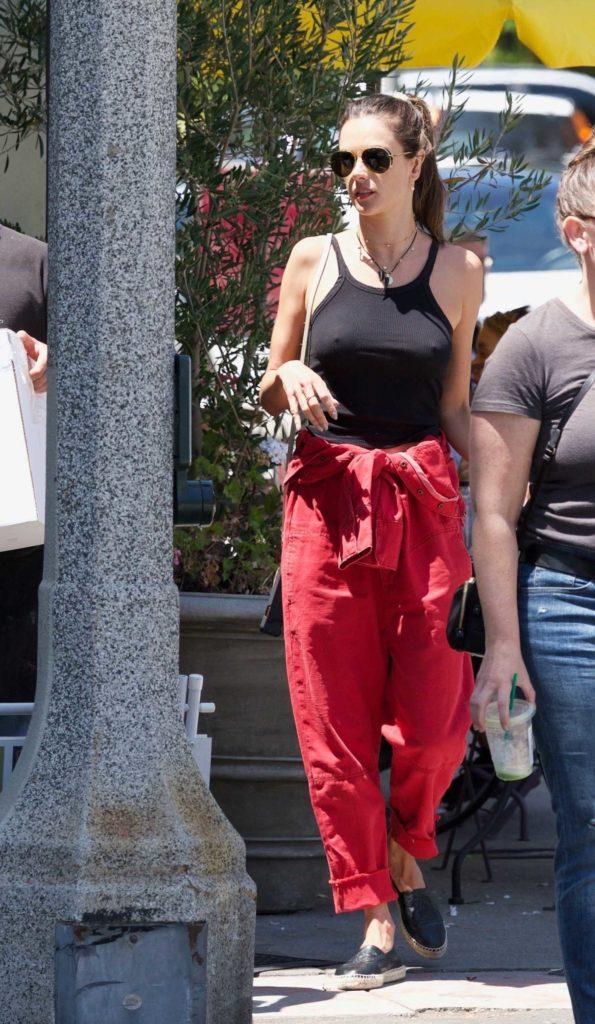 Alessandra Ambrosio in a Red Denim Jumpsuit