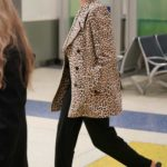 Anne Hathaway in a Leopard Print Blazer Arrives at JFK Airport in New York
