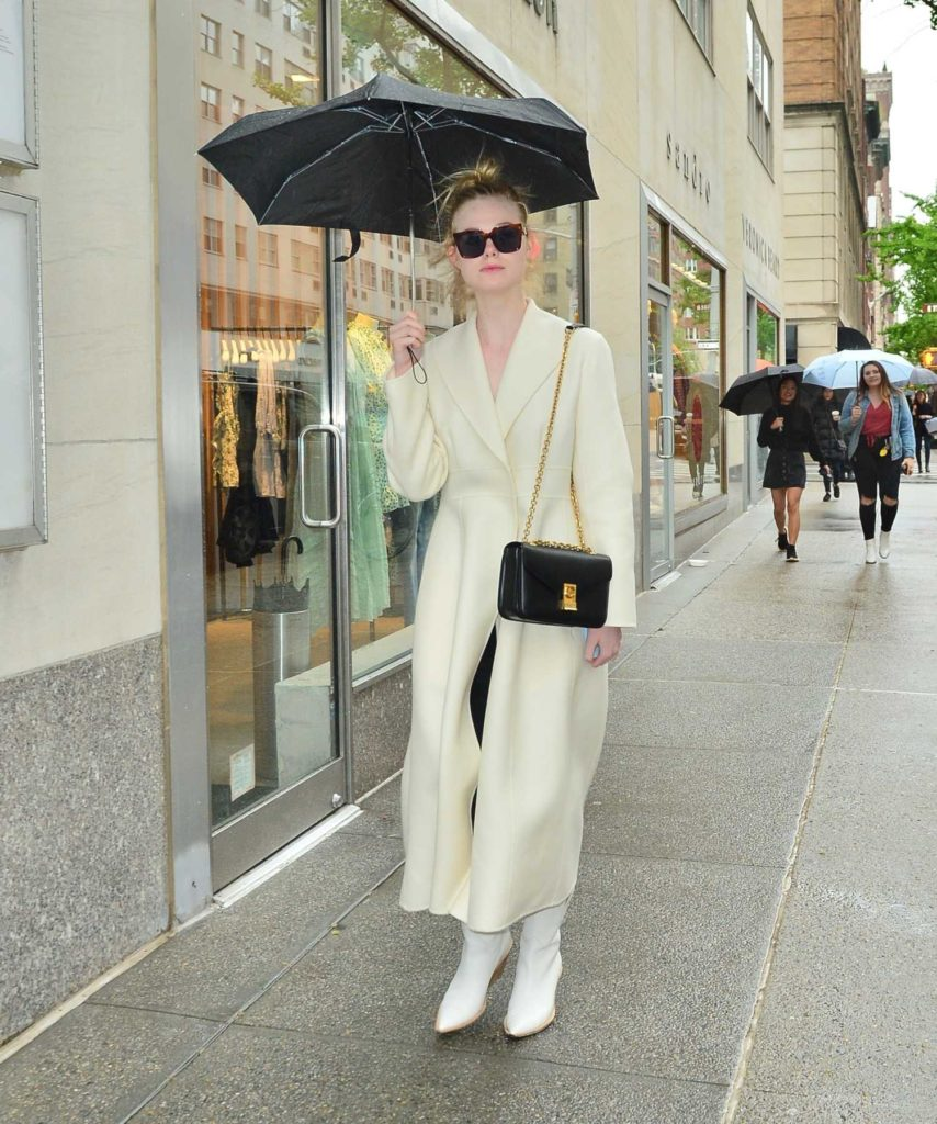 Elle Fanning in a White Coat
