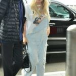Kesha in a Striped Jumpsuit Arrives at LAX Airport in Los Angeles