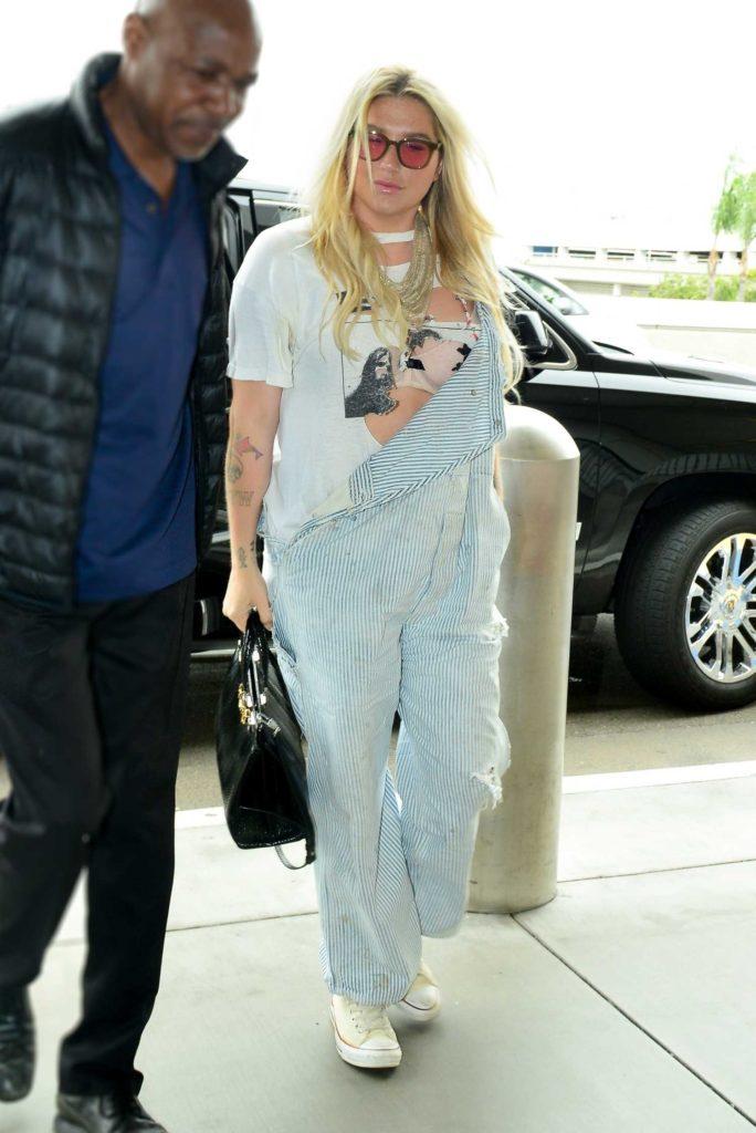 Kesha in a Striped Jumpsuit