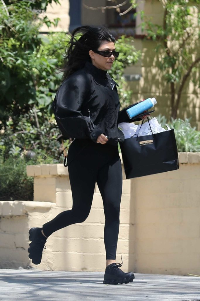 Kourtney Kardashian in a Black Leggings