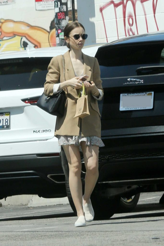 Lily Collins in a Beige Blazer