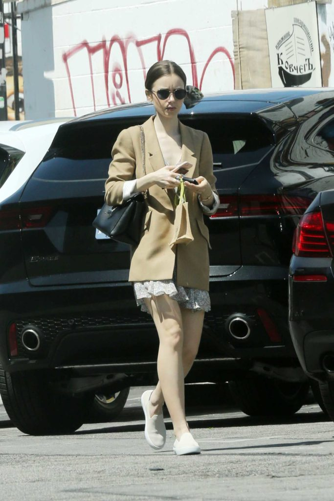 Lily Collins in a Beige Blazer