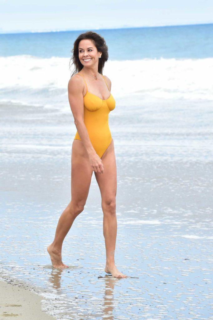 Brooke Burke in a Yellow Swimsuit