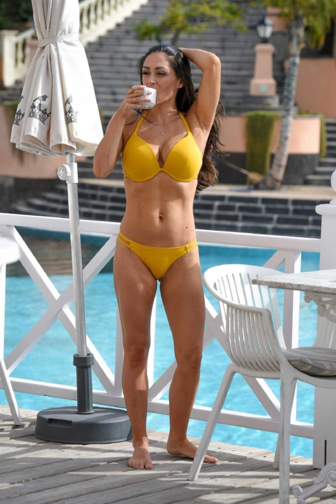 Casey Batchelor in a Yellow Bikini