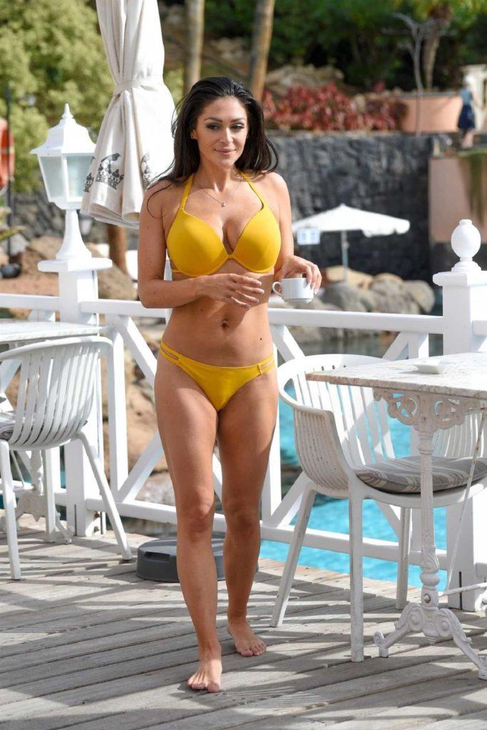 Casey Batchelor in a Yellow Bikini