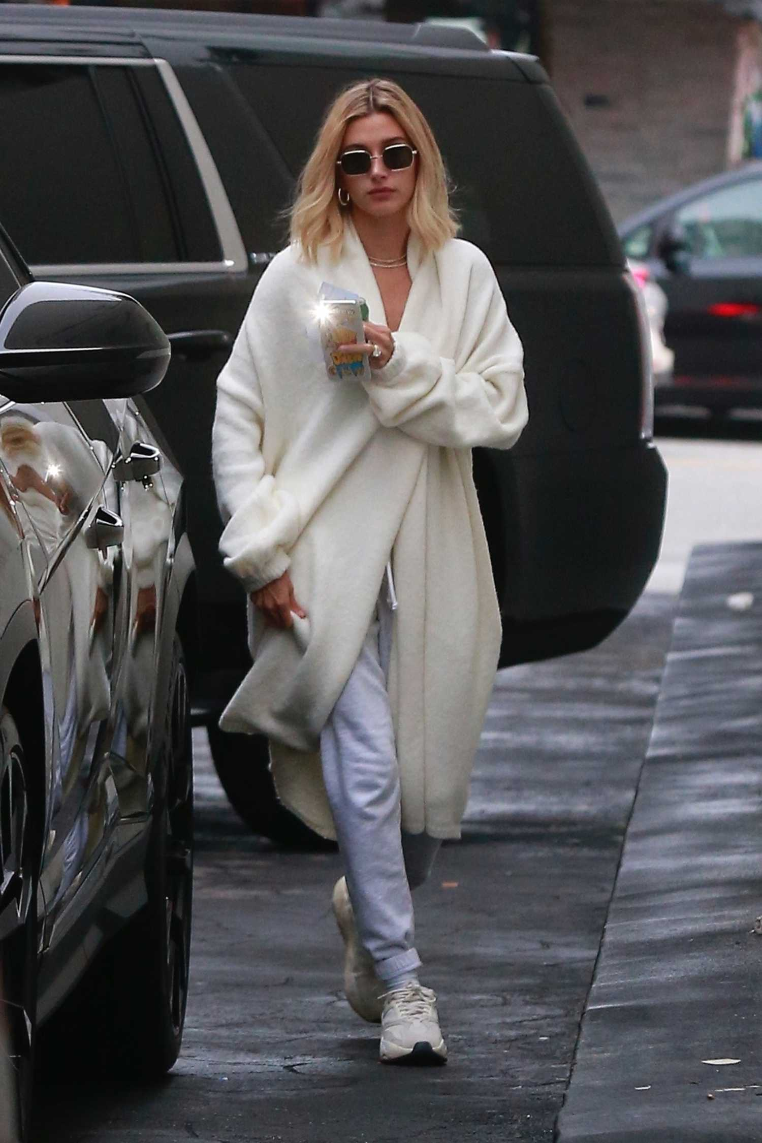 Hailey Baldwin in a White Cardigan Leaves a Dermatologist