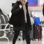 Jennifer Lawrence in a Brown Hat Arrives at JFK Airport in New York City