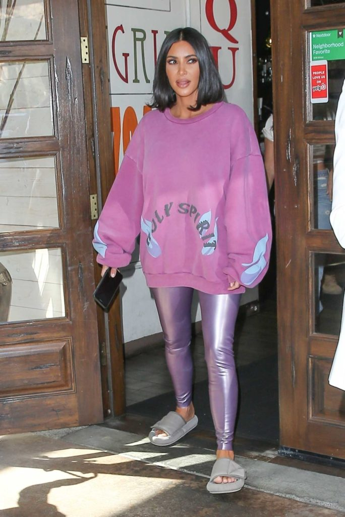 Kim Kardashian in a Purple Oversized Sweatshirt