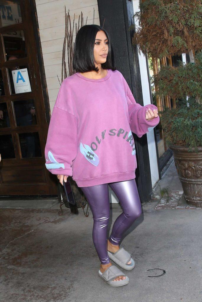 Kim Kardashian in a Purple Oversized Sweatshirt