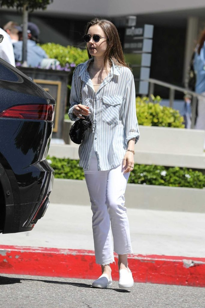 Lily Collins in a White Pants