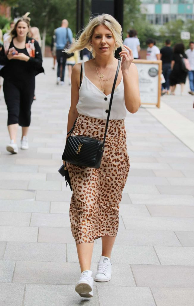 Mollie King in a Leopard Print Skirt