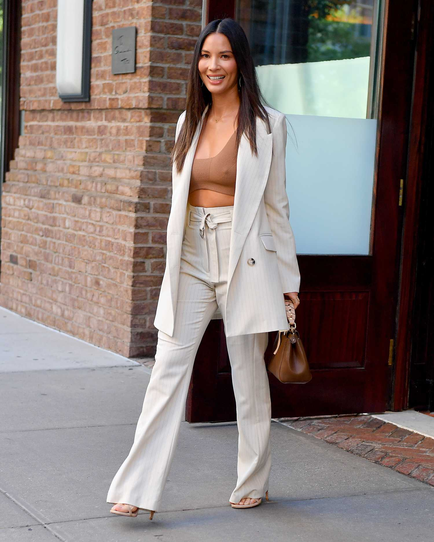 Olivia Munn In A White Striped Suit Was Seen Out In New