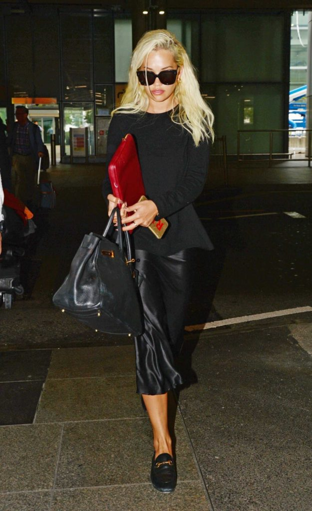 Rita Ora in a Black Sweater