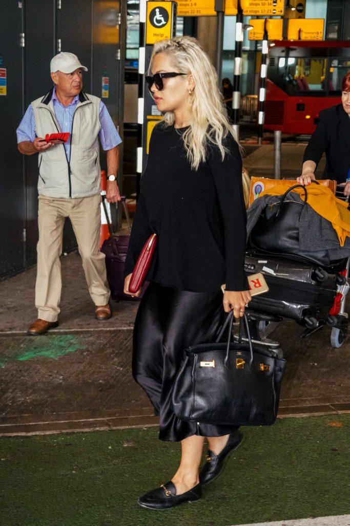 Rita Ora in a Black Sweater