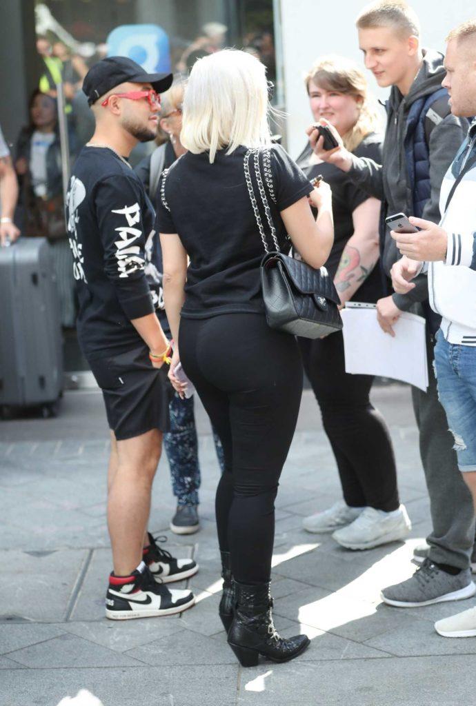 Bebe Rexha in a Black Blouse