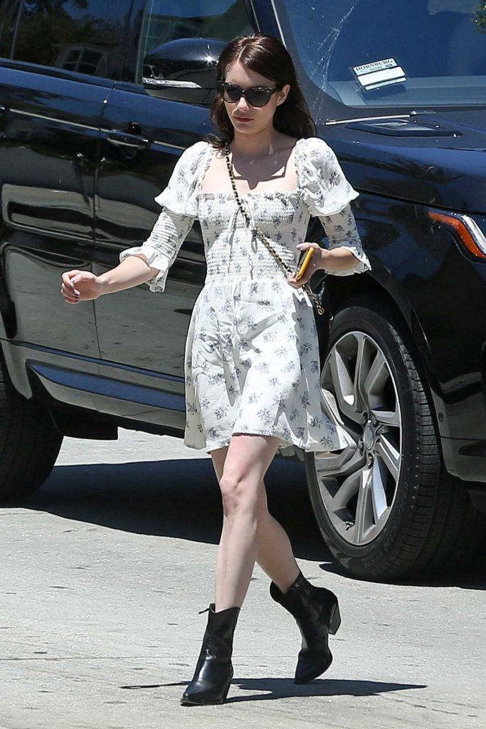 Emma Roberts in a White Floral Dress