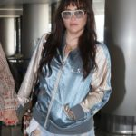 Kesha in a Blue Ripped Jeans Arrives at LAX Airport in Los Angeles