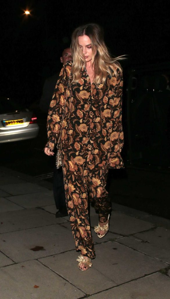 Margot Robbie in a Floral Suit