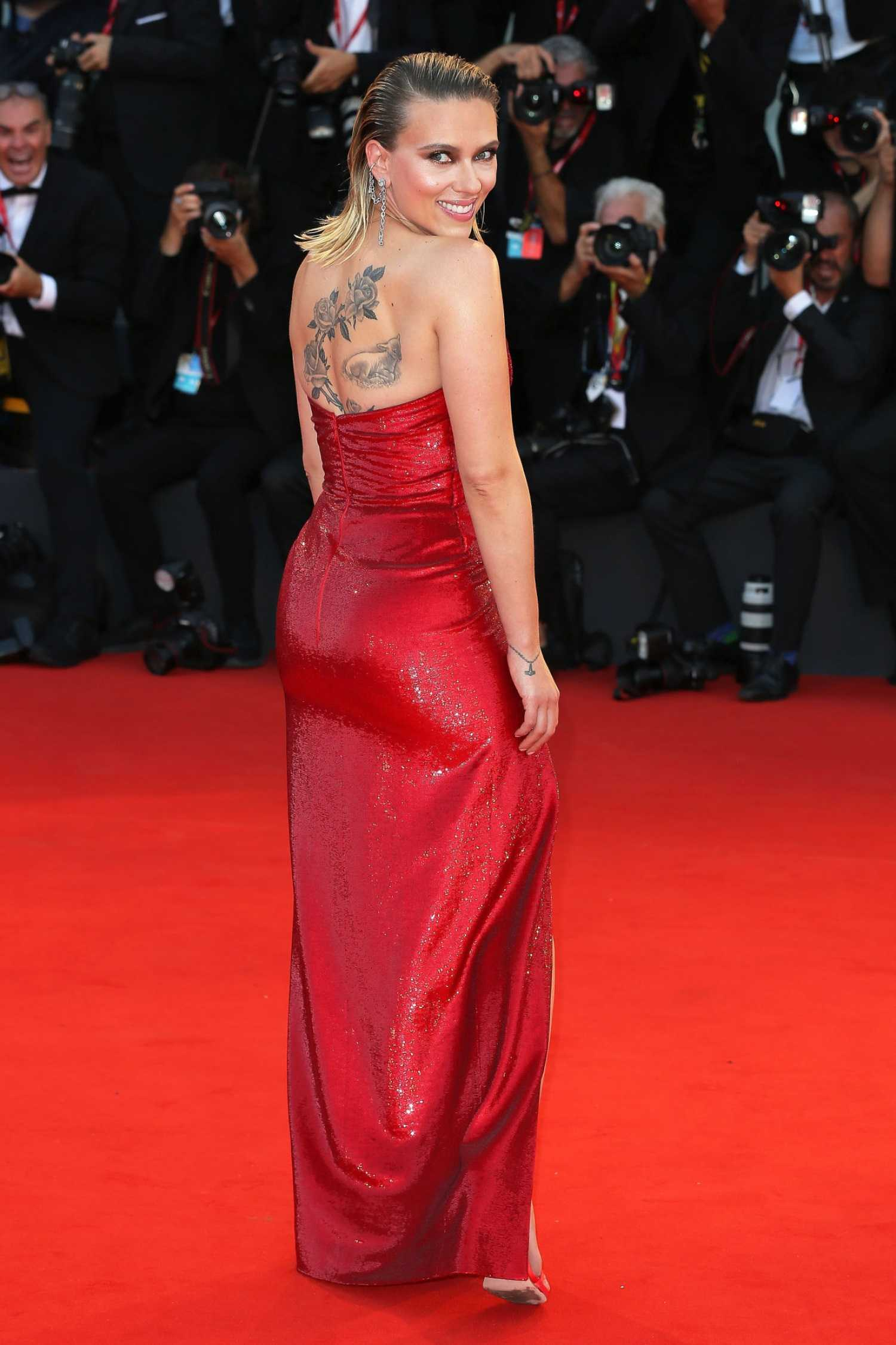 Scarlett Johansson In A Red Dress Attends The Marriage