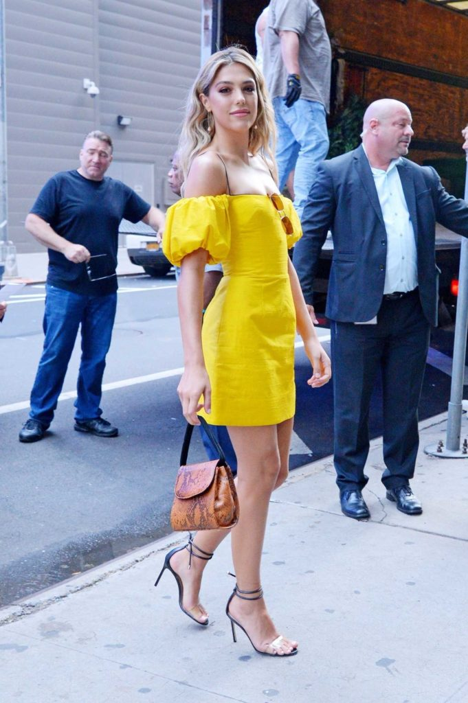 Sistine Stallone in a Yellow Dress