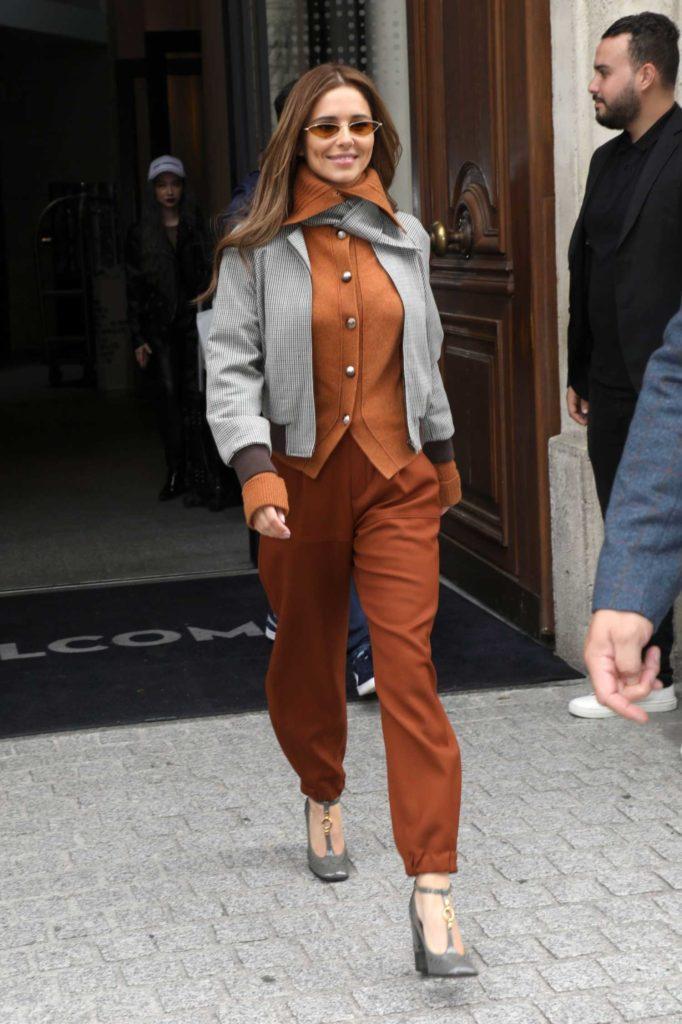 Cheryl Tweedy in a Gray Jacket