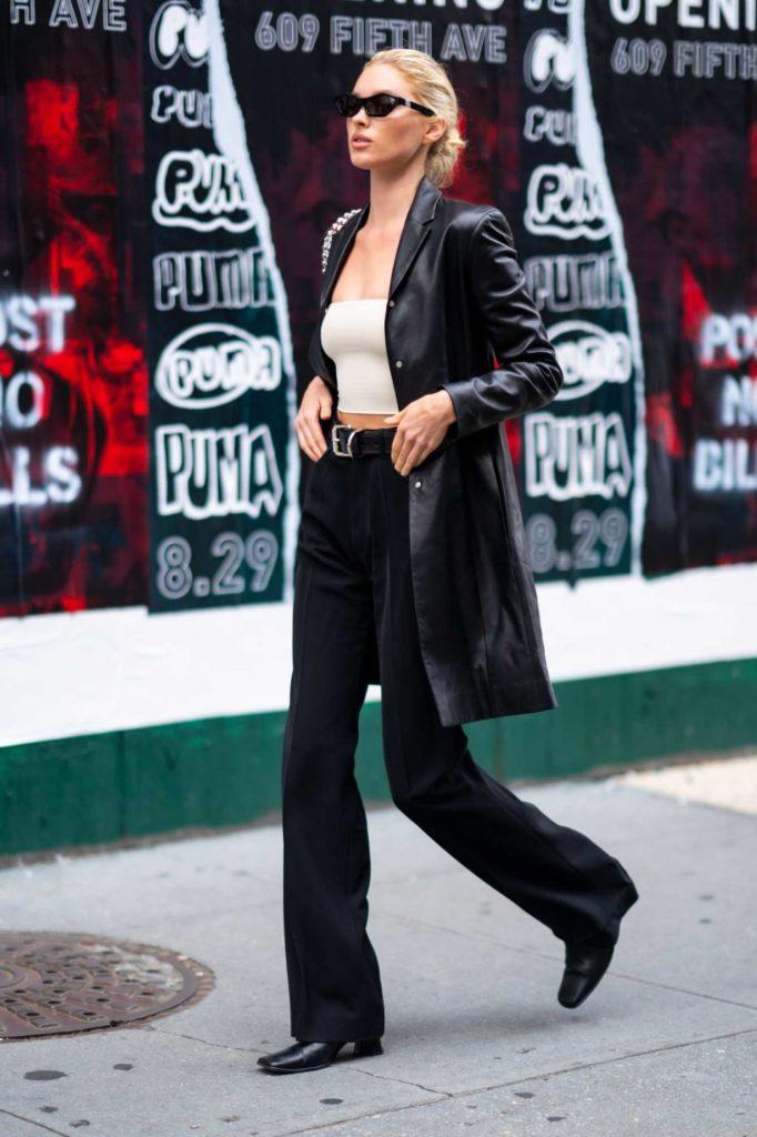 Elsa Hosk in a Black Trench Coat